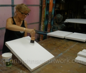 Jana priming her canvases